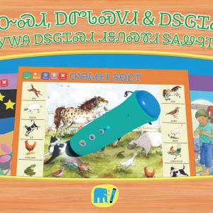 Cover image of the flipchart collection Touch, Listen and Learn in Cherokee language. The cover shows some of the flipcharts inside, and the talking pen PENpal that you would use to listen to the audio-enabled flipcharts