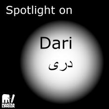 """A dark image with a white spotlight and the words """"spotlight on Dari"""" and the Dari word for the language"""